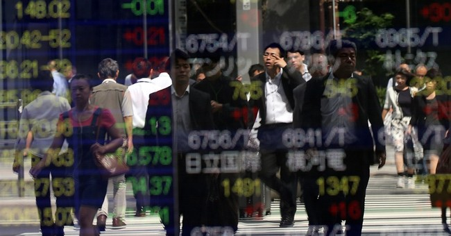 Asia stocks mostly lower, BOJ policy unchanged ahead of Fed