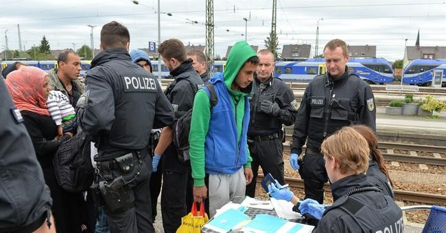 Razor-lined boxcar marks Hungary's new border for migrants
