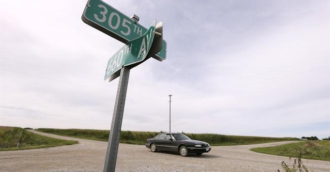In corn-growing states, tall crops pose seasonal road hazard