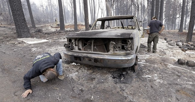 The Latest: 720 homes destroyed by 2 California fires