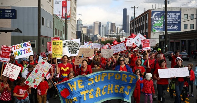 The Latest: Seattle teachers union panel votes to end strike