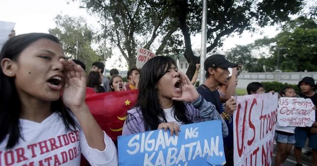 Police break up protest at US Embassy in Manila