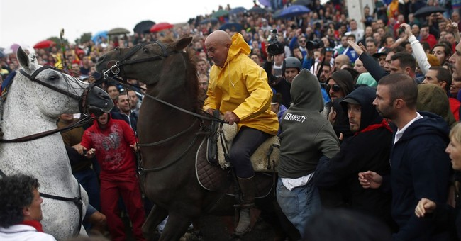 Men on horseback in Spain spear bull to death amid protests