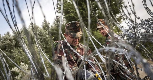 Hungary declares emergency, seals border, detains migrants