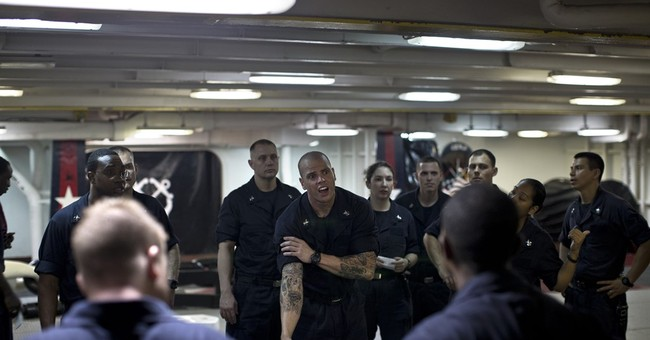AP PHOTOS: Life on US aircraft carrier in Islamic State war