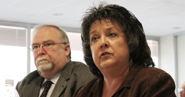 The Latest: Embattled NM secretary of state visits offie