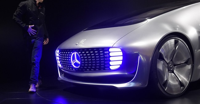 Tech disruption hangs over automakers at Frankfurt show
