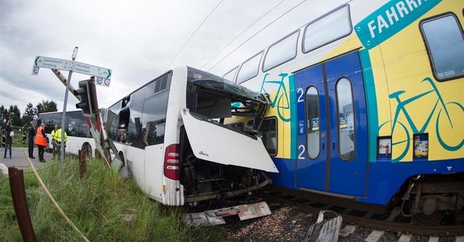 Train hits school bus in Germany; children safe