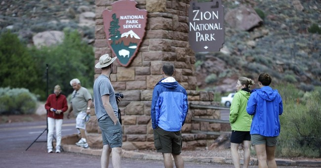 Floodwaters trap hikers, carry away cars in Utah, killing 16