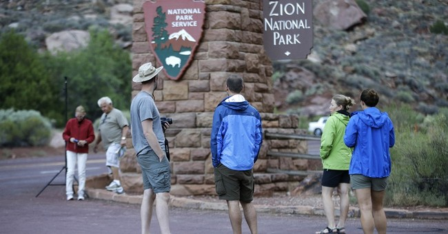 The Latest: Rangers: 7 hikers warned before flash flooding
