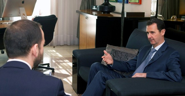 Syrian president dismisses talks with 'puppets' in interview