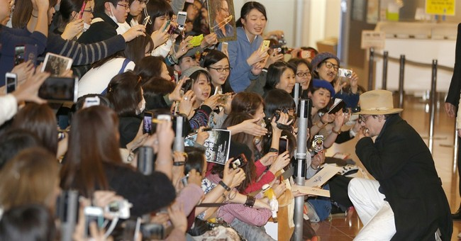 Image of Asia: Greeting Johnny Depp at the Tokyo airport