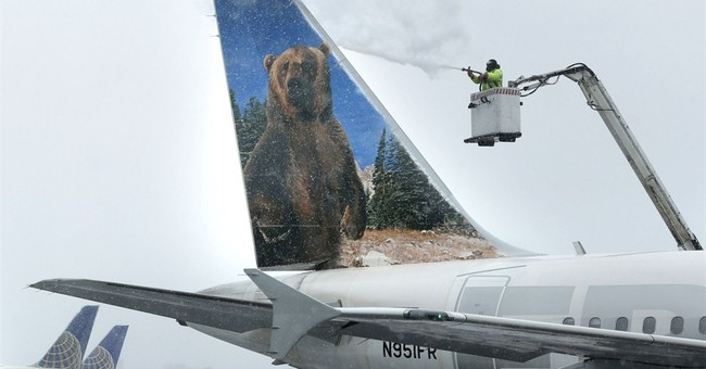 As storm rushes in, airlines cancel while salt sellers gain