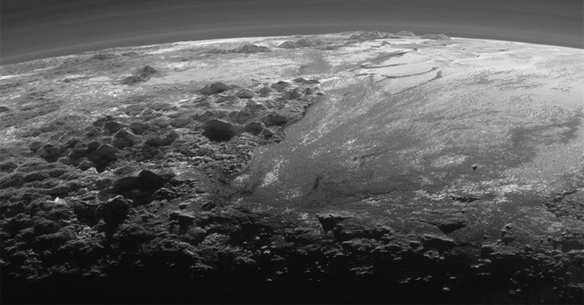 Sun provides dramatic backlighting for latest Pluto pictures