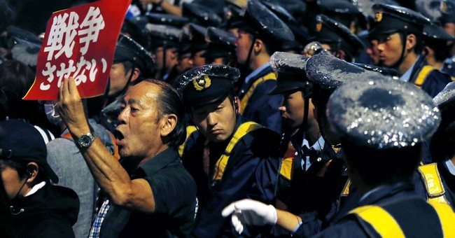 Q&A: A look at Japan's contentious security legislation
