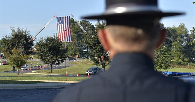 The Latest: Trooper's body brought to veterans cemetery