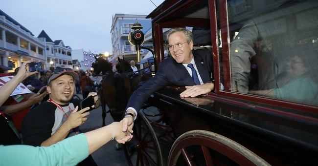 Bush says Obama's 'American,' calls for new civility