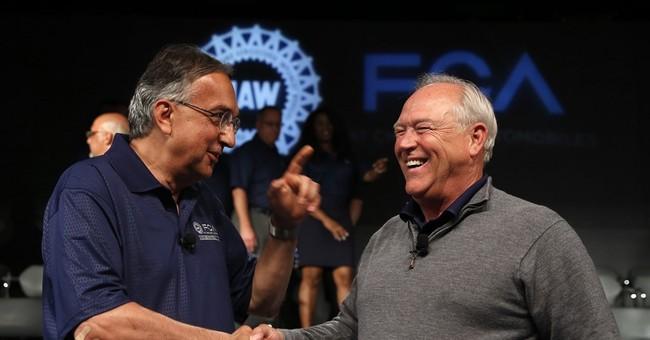 UAW-Fiat Chrysler pact raises pay, profit-sharing