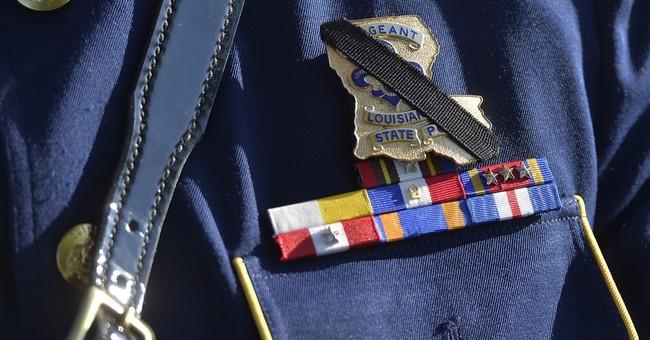 Slain Kentucky trooper remembered as hero at funeral