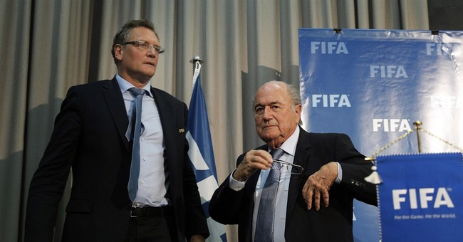 Blatter rallies FIFA staff after cutting ties with Valcke