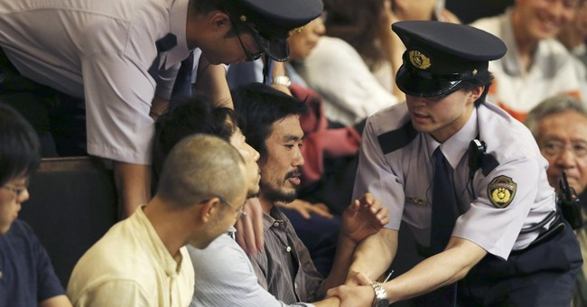 Japan enhances military's role as security bills pass