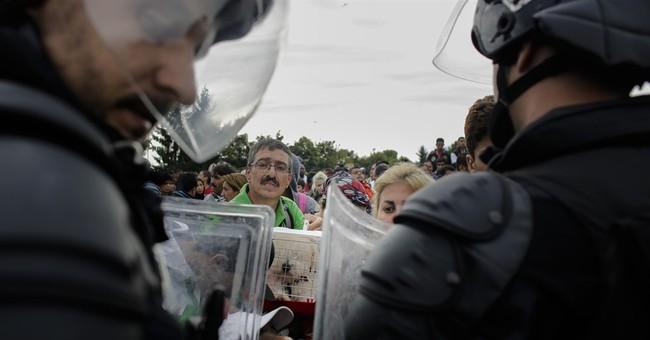The Latest:  Far-right Hungarian mayor warns migrants away