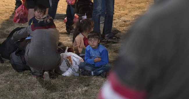 Joy as migrants flood into Austria; tears for those kept out