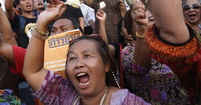 Pro-democracy protesters stage rare rally in Thai capital