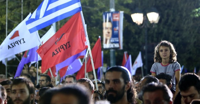 Resigned to years of austerity, Greeks head to the polls