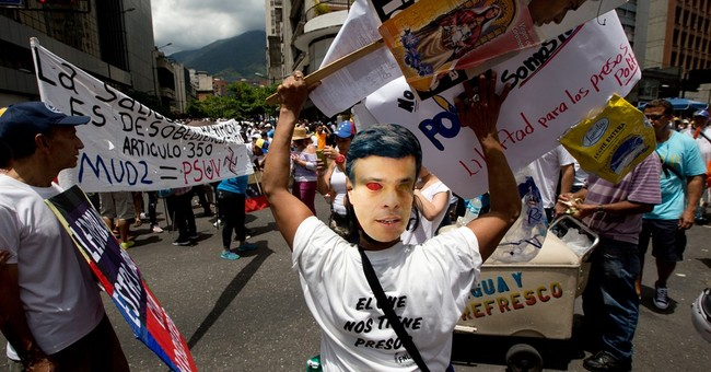 Venezuela's opposition rallies to protest leader's sentence