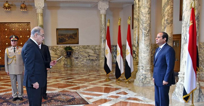 Egypt's president swears in new government