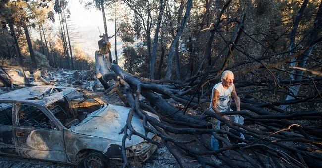 The Latest: 2 California fires destroy 2,800 buildings