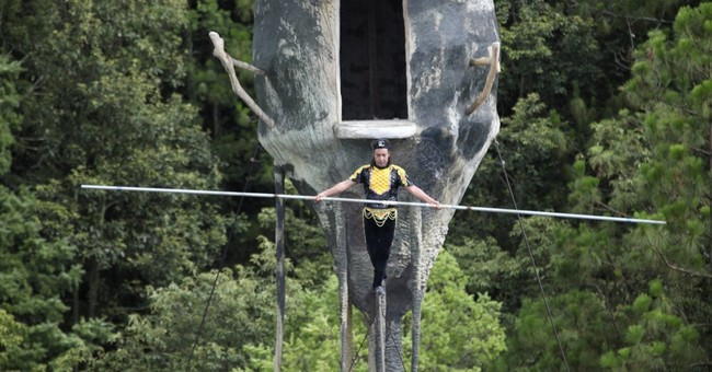 Chinese Uighur upholds long tradition of tightrope walking