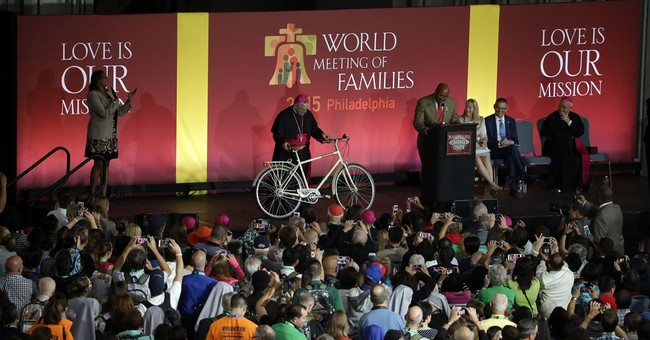 Philadelphia giving pope a bike with angel wing chain guard