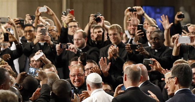Pope canonizes 18th-century missionary; not everyone happy