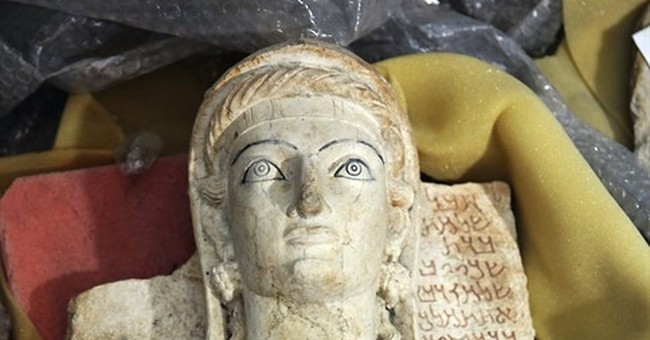 Racing against militant threat to document Syria's heritage