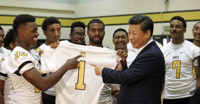 High school students give Chinese president football