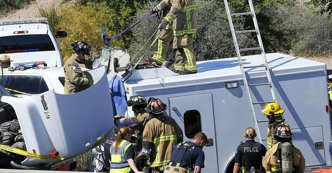 15 prisoners, driver hurt in Phoenix-area police van crash