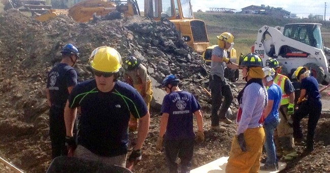 2 workers rescued after trench collapses in South Dakota