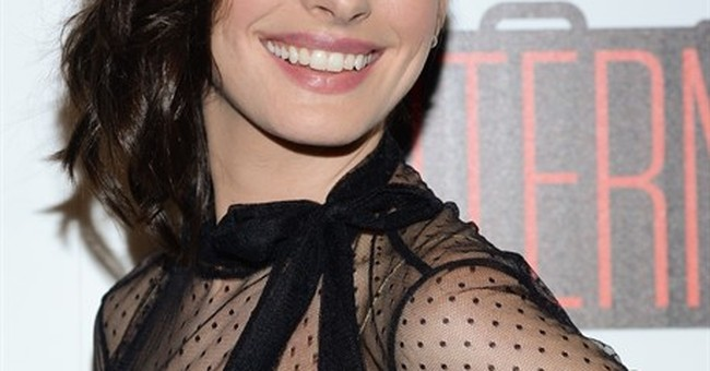Anne Hathaway geeks out over Mariah Carey at movie premiere
