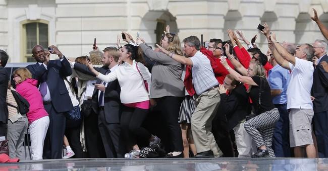 AP PHOTOS: Pope visits Congress, homeless in Washington