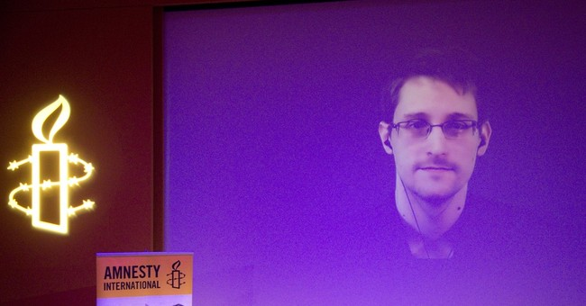 Snowden on video at NYC forum to promote privacy treaty