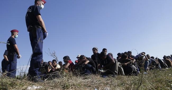 The Latest: Merkel, German states agree on migrant deal