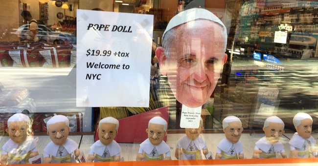 Bobblehead, umbrella, mug or magnet? Pope souvenirs abound