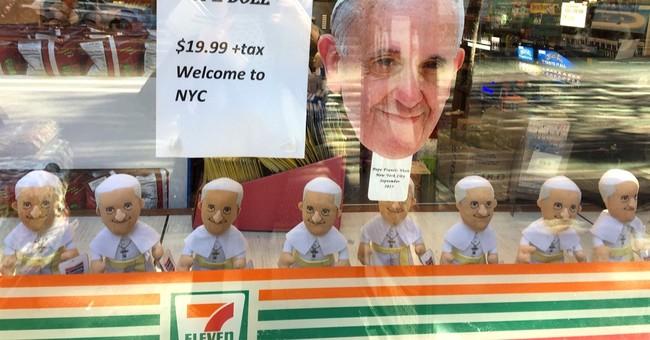 Bobblehead, umbrella, mug or magnet? Pope souvenirs abound