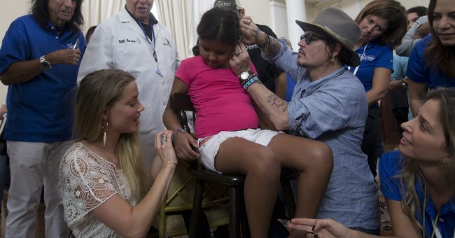 Musicians help give hearing devices to Rio residents