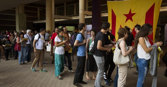 AP PHOTOS: Catalans fly the flag in campaign on independence