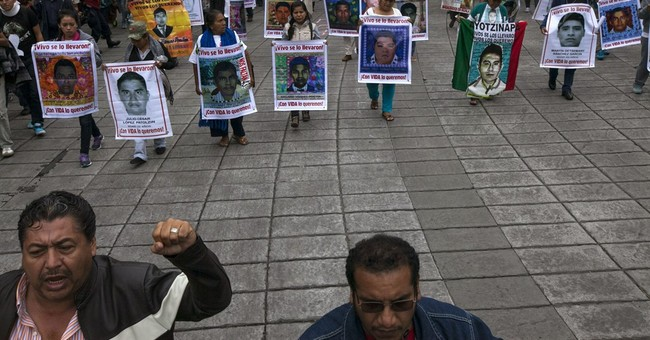 Mexicans march on anniversary of 43 students' disappearance