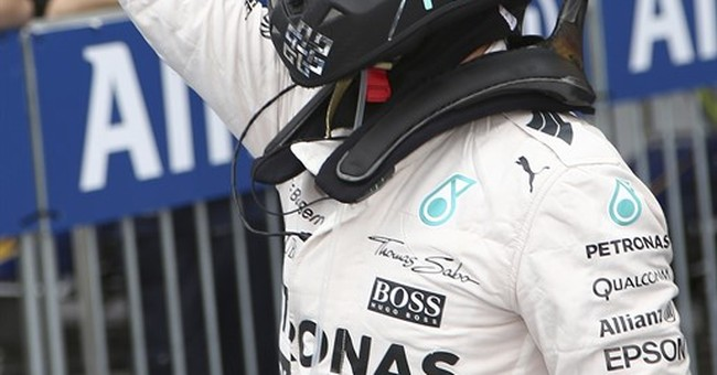 Mercedes' Rosberg takes pole at Japanese GP