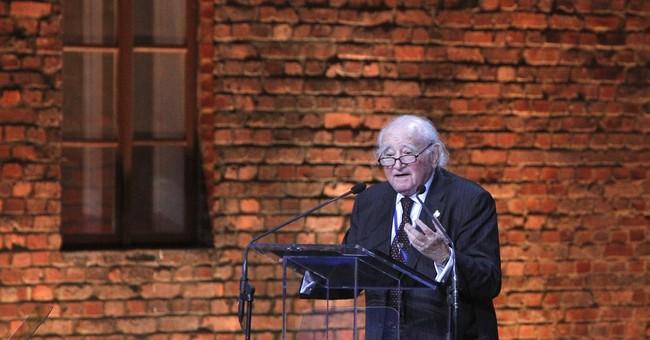 On Auschwitz anniversary, leader warns Jews again targets